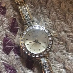 GUESS watch. Stones in tact, slight wear shown